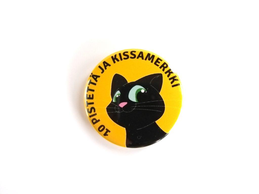10 pistettä ja kissamerkki pinssi magneetti keltainen